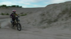 Dirtbike dune channel berm with slo mo Stock Footage
