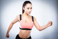 Sporty Asian Girl Running Pose Stock Photos