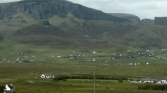 View overlooking the village of Staffin on the Isle of Skye, Scotland Stock Footage