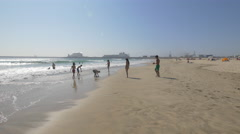 Teens picking up sand and playing in the water, Porto Stock Footage