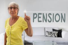 Pension touchscreen is shown by senior - stock photo