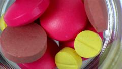 Pills in a glass loop rotating Stock Footage