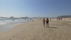 Tourists enoying the beach and kids playing in the sand, Porto Stock Footage