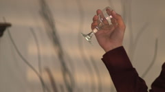 Man throws wine glass from his hand Stock Footage