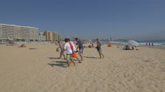 A group of boys leaving the beach and other tourists relaxing, Porto Stock Footage