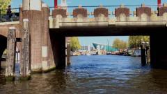 Tourist trip along river channel. The ship sails under the bridge. Stock Footage