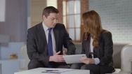 Stock Video Footage of Business colleagues at meeting, man woman discussion slow-motion