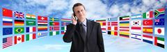 International businessman talking on the phone, global communication - stock photo