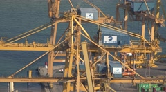 4K Closeup crane machine work port load unload ship industrial equipment dock  Stock Footage
