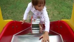 Girl riding on a sliding board Stock Footage