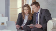 Stock Video Footage of Business lady and man check presentation on laptop, slow motion