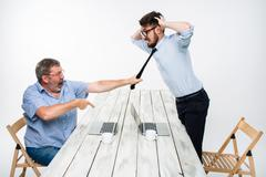 Business conflict. The two men expressing negativity while one man grabbing the - stock photo