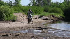 Dirtbike wheelie in water Stock Footage