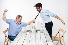 Business conflict. The two men expressing negativity while one man grabbing the Stock Photos