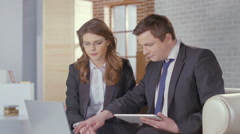 Male and female business partners come to agreement, shake hands Stock Footage