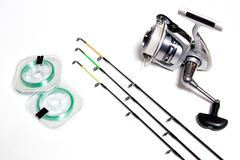 Fishing accessories on white background. - stock photo