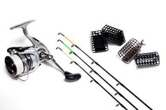 Fishing feeder and reel with accessories on white background Stock Photos