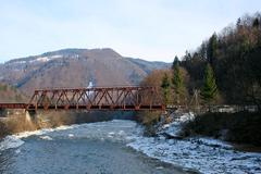 Panoramic view of the old bridge and mountain landscape on background - stock photo