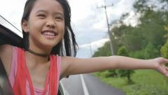 Stock Video Footage of Little Girl Playing on Window Car, Family Traveling on Countryside.