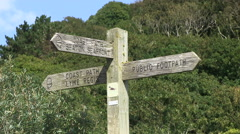 Stock Video Footage of Wooden Coast Path and Public Footpath Sign Seaton Lyme Regis
