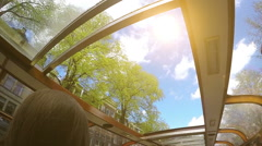 Boat excursion on a sunny morning in Amsterdam: a view through the glass roof Stock Footage