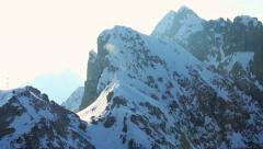 Sun shining brightly in snowy mountains, glacier on top of Alps Stock Footage