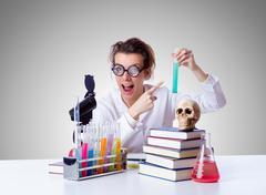 Crazy female chemist in lab Stock Photos