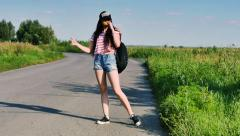 Stock Video Footage of beautiful young girl hitchhiking travels