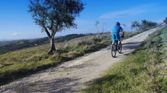 Cyclist in Tuscan landscape Stock Footage