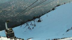 Modern cable car lifting tourists to skiing run, mountain resort Stock Footage