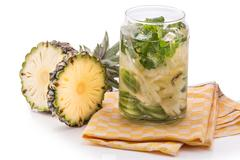 Stock Photo of Infused fresh fruit water pineapple, cucumber and mint .isolated over white