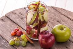 fresh fruit Flavored infused water mix of Apple, grape and cinnamon - stock photo