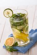 fresh fruit Flavored infused water mix of citrus and basil - stock photo