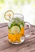 fresh fruit Flavored infused water mix of starfruit, mint and lime - stock photo