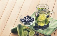 fresh fruit Flavored infused water mix of cucumber and blueberry - stock photo