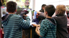 Kids are playing Video Arcade Game in Game center - stock footage