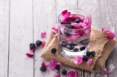 fresh fruit Flavored infused water mix of blueberry and rose - stock photo