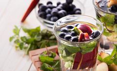 fresh fruit Flavored infused water mix of blueberry, apple and mint - stock photo