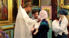 Christening of little baby in orthodox church Stock Footage