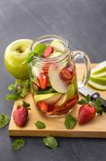 Stock Photo of fresh fruit Flavored infused water mix of apple, strawberry and mint