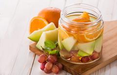fresh fruit Flavored infused water mix of orange, grape and melon - stock photo