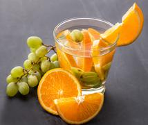 fresh fruit Flavored infused water mix of orange and grape - stock photo