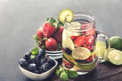 fresh fruit Flavored infused water mix of Strawberry, grape and - stock photo