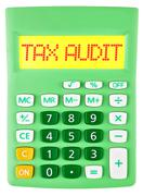 Calculator with TAX AUDIT on display on white - stock photo