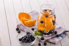 fresh fruit Flavored infused water mix of orange, blueberry and mint - stock photo