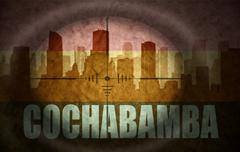 sniper scope aimed at the abstract silhouette of the city with text Cochabamb - stock illustration