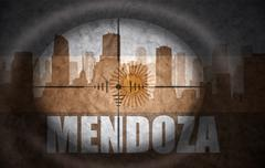 sniper scope aimed at the abstract silhouette of the city with text Mendoza a - stock illustration