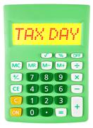 Calculator with TAX DAY on display on white - stock photo