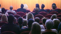 Crowd watches stage in auditorium Stock Footage