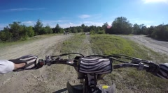 Motocross trail jump pov Stock Footage